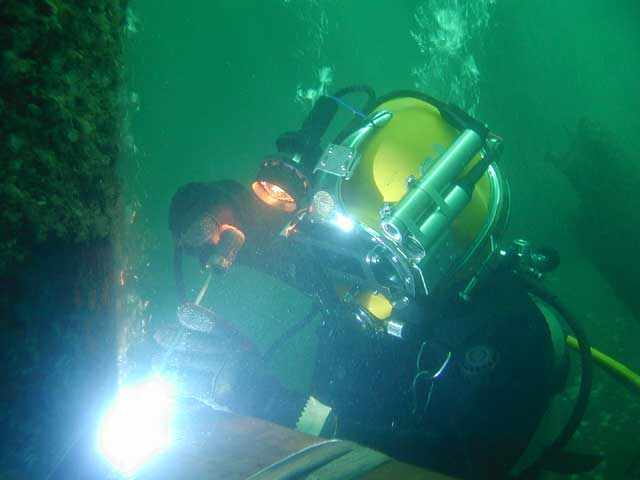 Diver welding using A.G.O. underwater camera and laser in a helmet mount